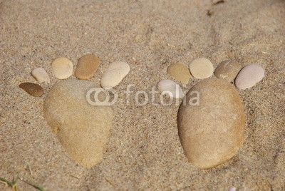 Stone feet on the sand