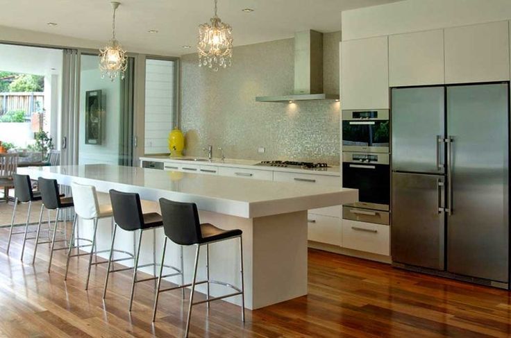 Open Kitchen Design Ideas with white marble islan and wooden floor in modern design