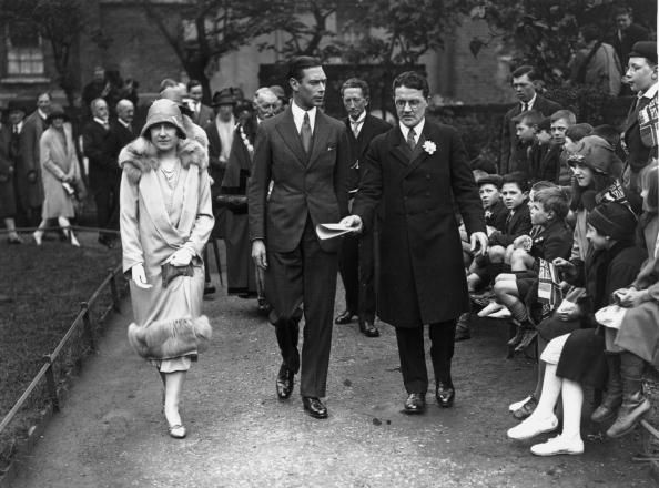 The Duke and Duchess of York later King George VI and Queen Elizabeth parents of Queen Elizabeth II visit the Browning Settlement in London A crowd...