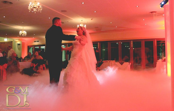 Dancing on a cloud at Shangri La Gardens Wynnum with red lighting | G&M DJs | Magnifique Weddings #gmdjs #magnifiqueweddings #weddinglighting #weddingdjbrisbane @gmdjs