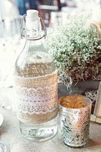 Clean old wine bottles; use for self serve water on tables. Make part of table centerpiece.