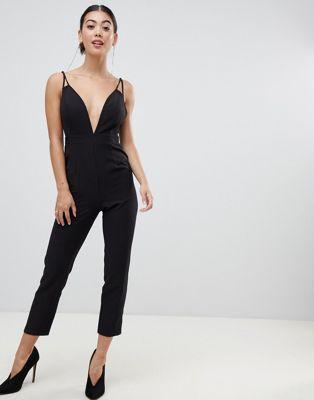 b3697b7176d8 Shop ASOS DESIGN Petite jumpsuit with plunge neck and peg leg at ASOS.  Discover fashion online.
