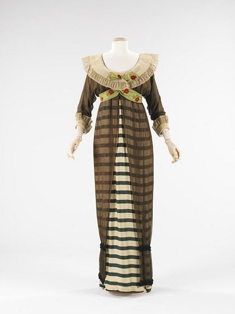 Paul Poiret 1910 Evening dress  Empire silhouette, tubular, low hanging sleeves with cuffs, low round neckline   Hobble skirt, sheer tunic overskirt, bertha collar.