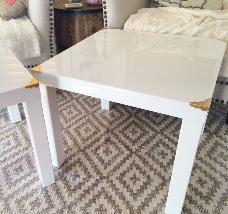 Easy IKEA hack... Add a little gold hardware to the IKEA lack side table in gloss