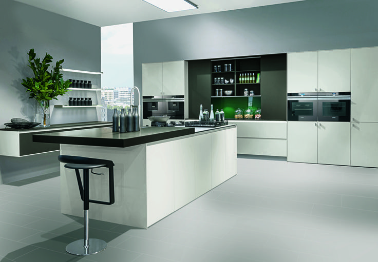 Pronorm Xerox Grey X Line handleless kitchen. It features an island with seating and a sliding door area for enhanced storage.