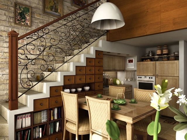Under stairs on way down - open railing, kitchenette, current dining table and hutch can be used here