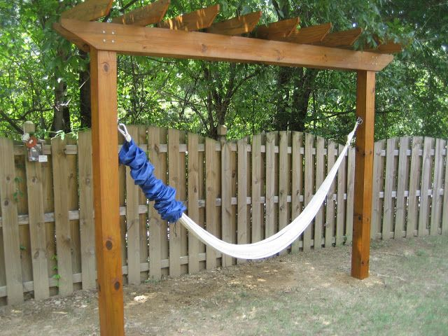 What a great idea! A hammock pergola. Build it with #redwood, and your structure will last you for several years to come!