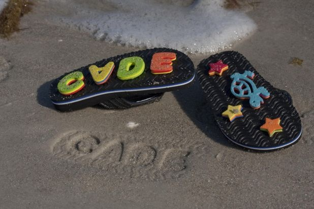 "Shoe/sand imprints from Family Fun reader. Reader Michelle Green's great idea: ""My kids and I hot-glued double layers of foam letters to the bottom of their flip-flops so that they'd leave fun prints when they walked in the sand. Just remember that the prints will be a mirror image, so arrange the letters backward."""