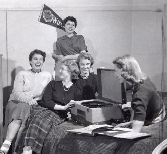 In a girls' dorm at the same time, women jammed to a record player.