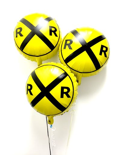 "Yellow railroad crossing mylar (foil) balloon pack. This train balloon has a imprint of the popular ""RR"" crossing road sign. Excellent room decor item for your little engineer's a train theme birthday party. You can place these balloons at the event/party entrance or use them as a centerpiece on your table with a balloon weight. Each package contains total 3 train balloons, measuring 18 inches in diameter when inflated. Balloons ship flat."