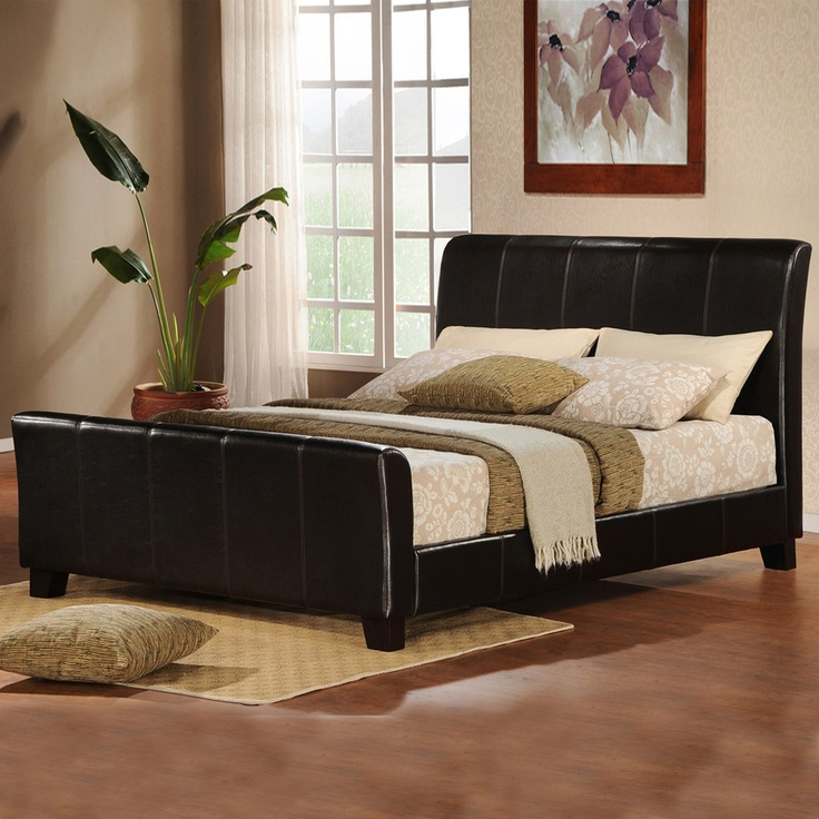 Transport yourself around the world when you slumber each night in this sleek upholstered queen bed with modern appeal. The traditional sleigh bed has been updated for today, but keeps its old-world feel with the dark brown headboard and footboard.