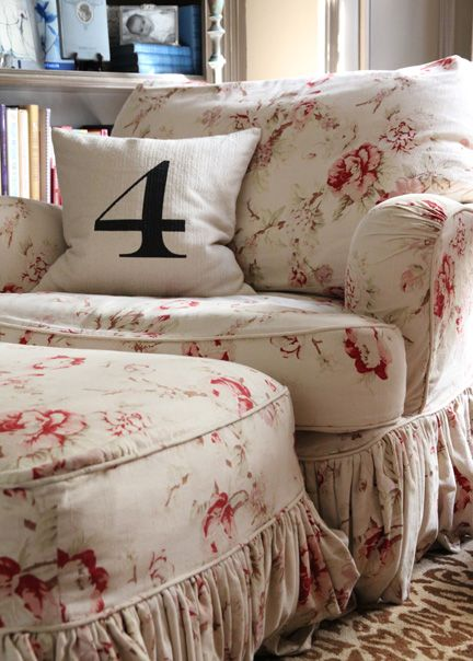 Quatrine slipcovered Milan chair with coordinating ottoman.   so cozy to cuddle up in.   love the floral fabric with the contrasting number pillow.