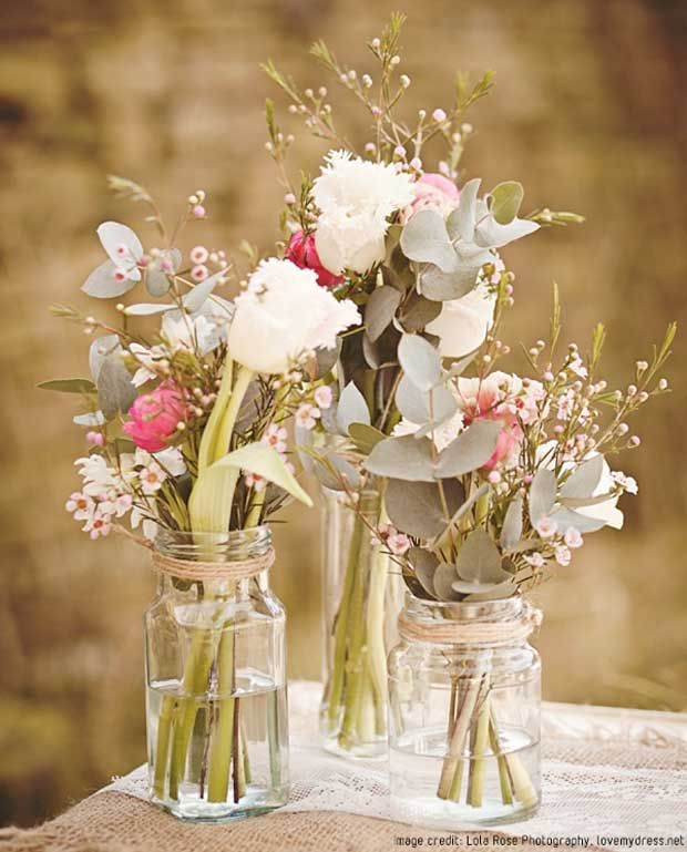 You can decorate your tables at your wedding reception with gorgeous flowers in mason jars or old jam jars tied with brown string or raffia