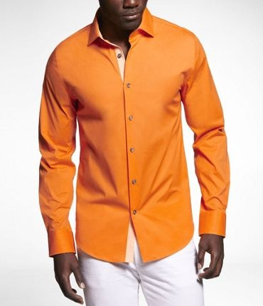 Orange seems to be everywhere this season. Here, it turns a dress shirt into a statement piece.