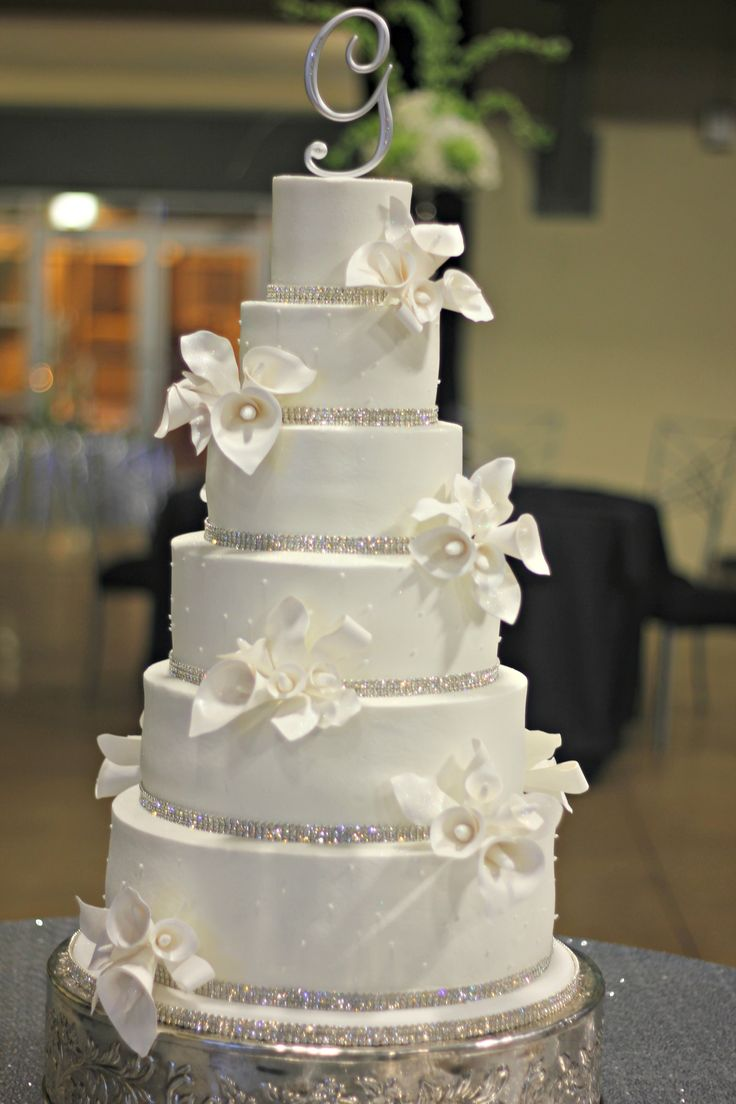 All buttercream 6 tier wedding cake with lots of sparkle!!!  Hand made calla lilies with sparkly centers.