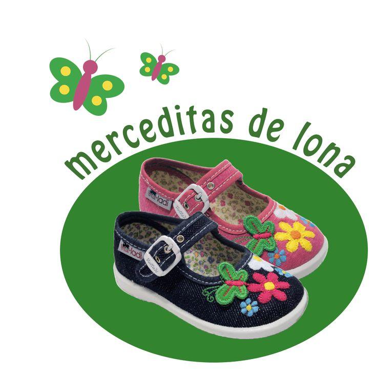 Merceditas de lona para #niña con apliques de mariposas y flores, en dos colores, en tejido tejano y en fucsia. Moda en #calzadoinfantil