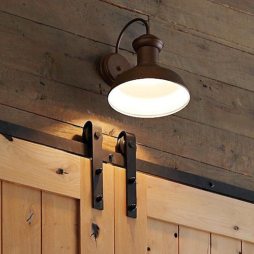 Who says your patio or sun room can't have a bit of style? The Fredricksburg Outdoor Wall Sconce by Sea Gull Lighting says otherwise with its classic station light design and eclectic selection of finishes. Its rounded body (with a White interior) contains a single recessed light source which provides plenty of ambient light while eliminating any extraneous spill, allowing you to enjoy the outdoors no matter what time of day it is.