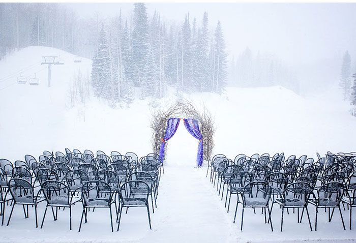 Winter wedding in snow From Amy Lashelle http://www.itakeyou.co.uk/wedding/purple-winter-wedding-photography/ Winter wedding ideas,purple winter wedding themes,wedding in snow,bride and groom in snow,winter wedding ceremony pine lodge