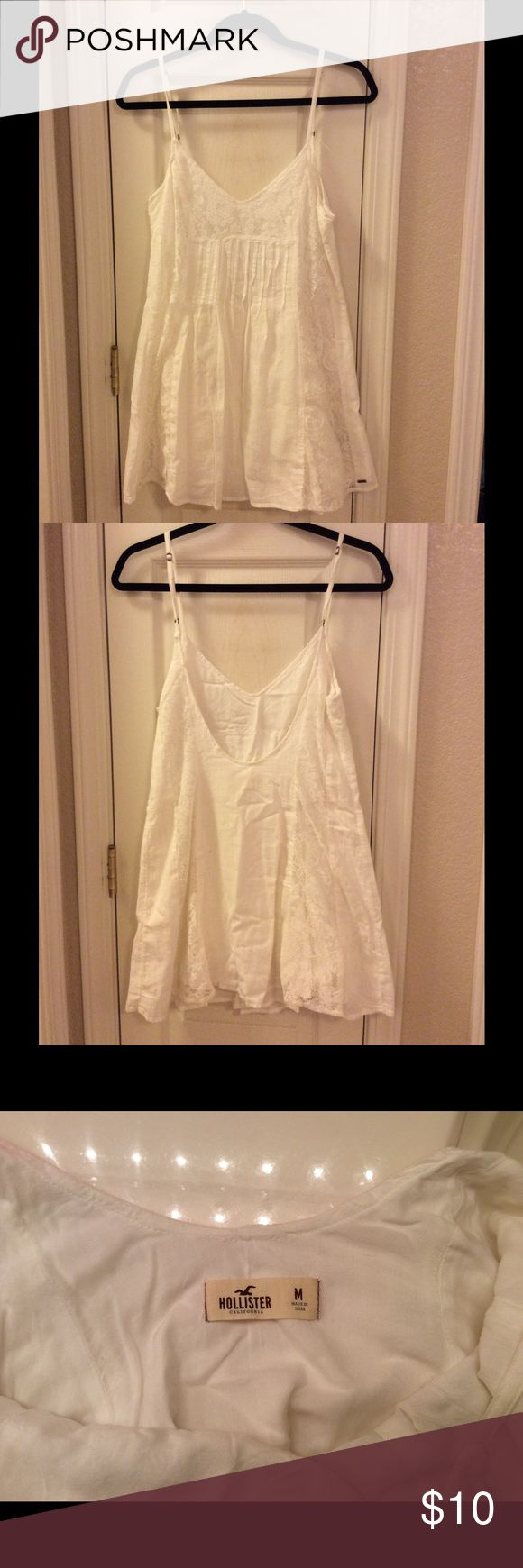 White Hollister dress White Hollister dress with lace, low back, and adjustable straps. Size Medium, sort of short but is really cute paired with cowboy boots! Hollister Dresses Mini