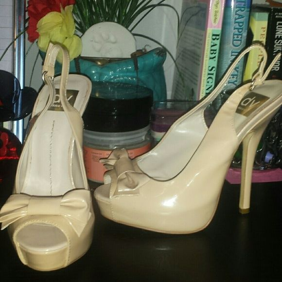 Cream high heels One is a size 7 and one is an 8 which I just now noticed. Ha! That's odd. Never worn. Just stored. Dolce Vita Shoes Heels
