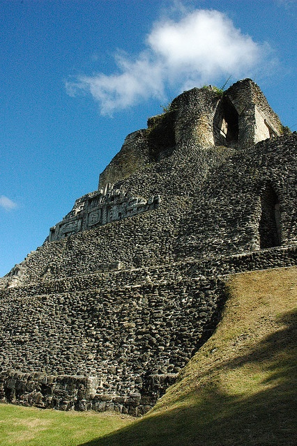 Xunantunich (pronouned Su-nan-tu-nich). It means Maiden of the Rock. It is the second tallest Maya ruin in Belize and is located across the river fromthe village of San Jose Succotz in the Cayo district.It stands 130ft (40 meters) high and gives a pa