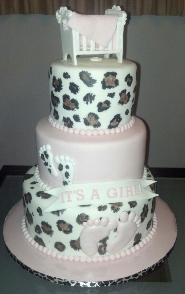 Leopard print, baby shower cake with gum paste footprints, crib, and blanket.