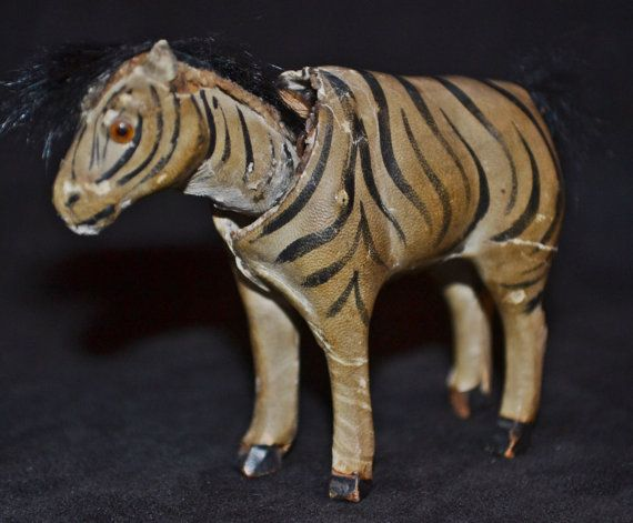 """Another one that has us stumped...  Vintage (possibly antique), nodder head zebra.  Seems to be paper-mache, or some kind of composite material.  Tail and mane could be animal fur.  Does have some nicks and scrapes.  2"""" tall x 2  1/2"""" long (not including mane or tail).    *If shipping is less than quoted, we will refund the difference if over $1*   Shop this product here: https://spreesy.com/collectitorium/89   Shop all of our products at https://spreesy.com/collectitorium      Pinterest…"""