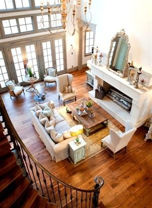 Open Living Area With Beautiful Fireplace Hardwood Floors And Upstairs Balcany Furniture ArrangementFurniture
