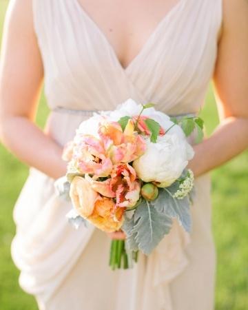 Bridesmaids' petite bouquets of peonies, parrot tulips, dusty miller, ranunculus, and wild viburnum by Sugar Magnolias (via Martha Stewart Weddings). Photo by Jodi Miller Photography.