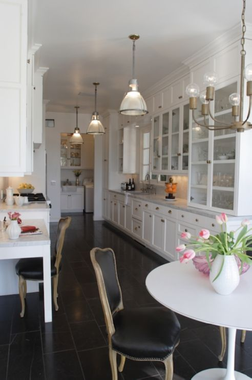 Breathing Room Design - Leslie Sachs - Gorgeous galley kitchen, love white kitchens, with the tulip table & french provincial black chairs