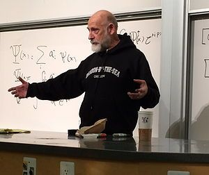 Leonard Susskind (NYC, 1940) is widely regarded as one of the fathers of string theory. His research includes studying quark confinement, the development of Hamiltonian lattice gauge theory, the theory of symmetry breaking sometimes -technicolor theory-, cosmological baryogenesis, string theory of black hole entropy, the principle of black hole complementarity, the causal patch hypothesis, M-theory, including development of the BFSS matrix model and the ultimately weird holographic…