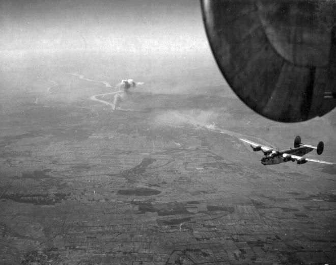 1944, Hungary, bombers over Fót, Buapest in the background, Ferencváros is in smoke, the plane is a B-24 Liberator http://www.fortepan.hu/
