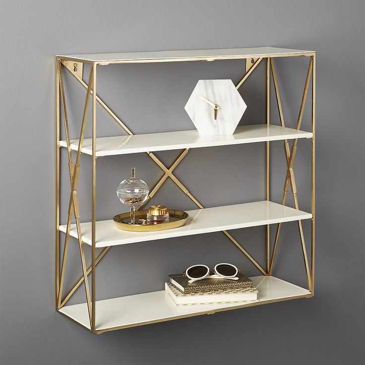 Shop Smith Large Brass Wall Shelf.   Frame stacks two enamel shelves for an open, airy design.  Perfect in the entry, bathroom or kitchen (think wine glasses, spice rack, etc. ).  Layer up for more storage/drama.