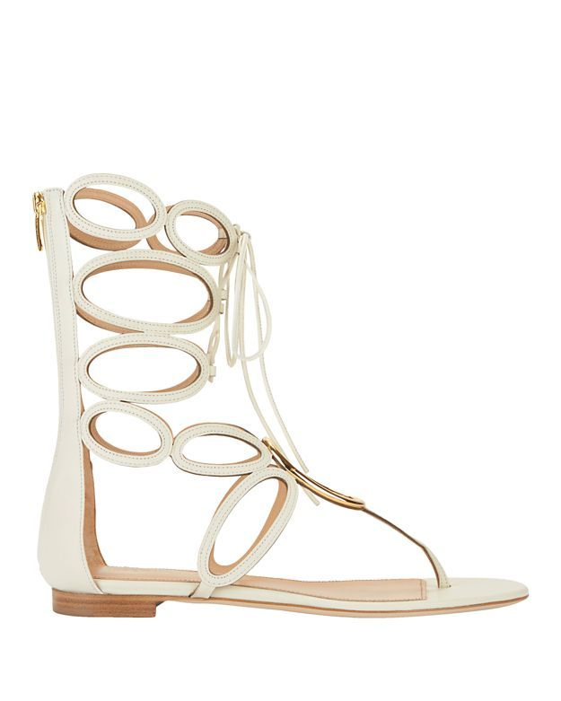 Sergio Rossi Farah Metal Ring Detail Leather Flat Sandal: White: Circular gold-tone metal details the vamp on these flat sandals. Lace-up and back heel zip closure. Leather sole. In white leather.  Made in ...