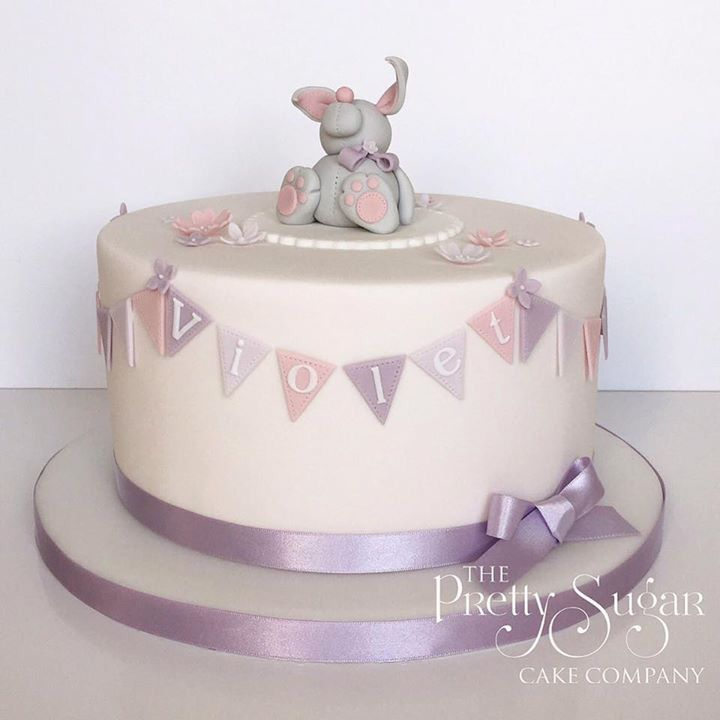 Pink and lilac christening cake with bunting and bunny detail