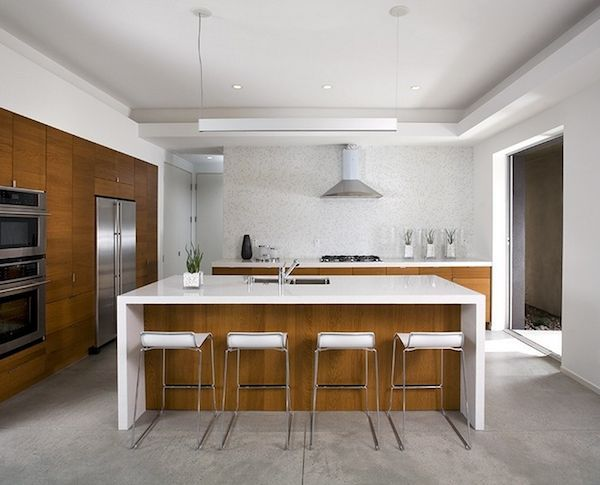 Wood Cabinetry + High Gloss White Create An Understated