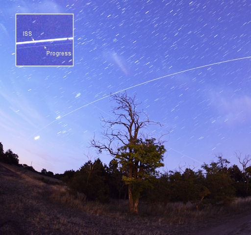 "The International Space Station is not alone. A Russian supply ship (the Progress M-15M) is chasing the ISS in its orbit around Earth. Picture was taken over Veszprem, Hungary, on the morning of July 24th. ""As the ISS emerged from the shadow of Earth a faint small dot following the space station. It was the Progress M-15M"". ""The Progress was well visible until it reached the dawn-bright sky in the east.: Progress M15M"