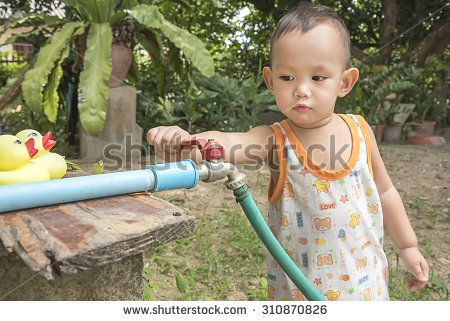 Kid  using hand close faucet to turn off water