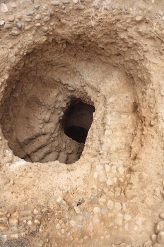 Archaeology Site... It appears to be a ceremonial well at El Brujo Archaeological Complex in Peru.
