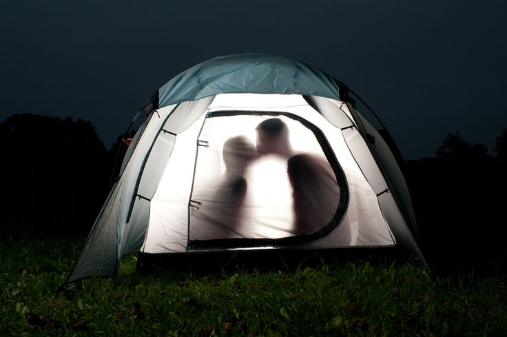 Silhouettes of two lovers in tent