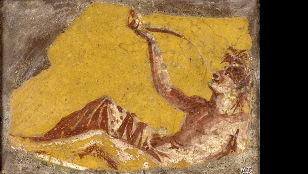 Fragment of a wall painting showing a man reclining to drink. From Pompeii, 1st century AD