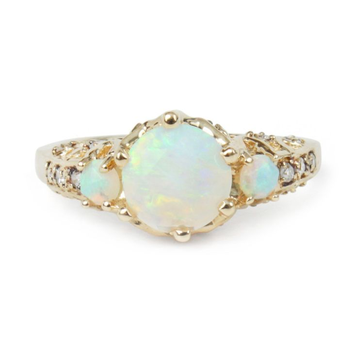 ManiaMania ceremonial opal ring: http://www.stylemepretty.com/2016/05/31/unique-nontraditional-engagement-ring/