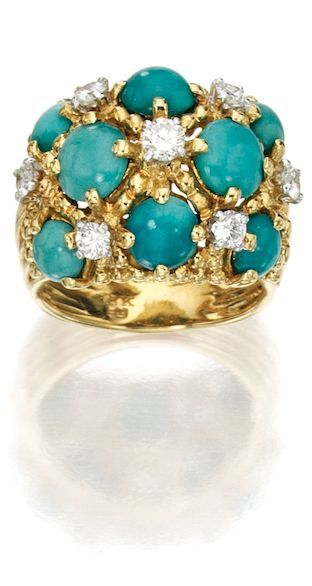 8 KARAT GOLD, TURQUOISE AND DIAMOND RING, CARTIER Of bombé form, set with eight turquoise cabochons accented by round diamonds weighing approximately .65 carat, size 6, signed Cartier