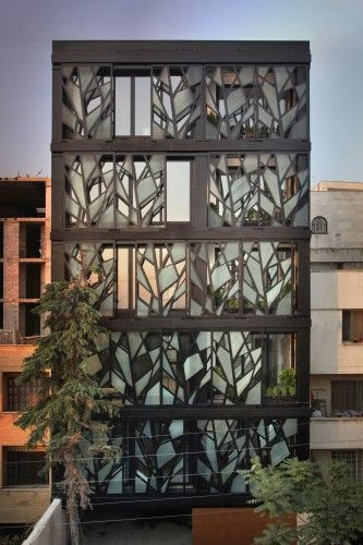Danial apartment building, Tehran. The whole exterior facade is consisting of 20 tree-like panels. Each floor's façade is covered by 4 of the panels which complete each other two by two, all installed on two rails which can be moved manually all along the rails horizontally, providing infinite choices to the resident who can control the panels from inside.