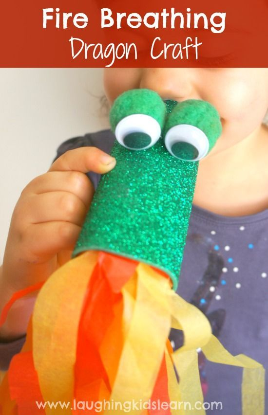 Toilet roll craft fire breathing dragon kids blow to develop oral motor skills. Simple to make craft and fun to play with.