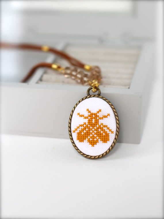 Handembroidered Bee necklace Cross stitch jewelry by byKALYNKA, €17.00 - why do I like this so much?