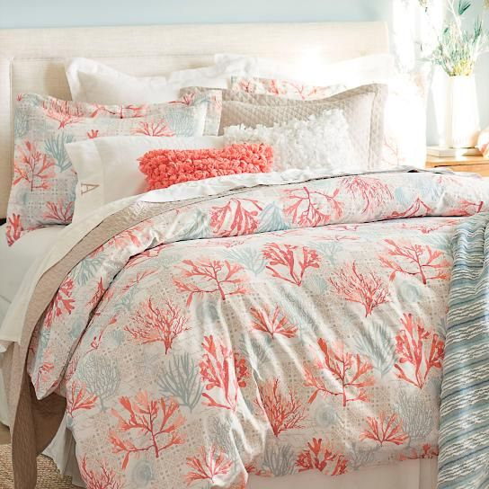 The Cape May Duvet Cover can add sweet summery life to your bedroom, or guestrooms. Its charming coastal pattern may remind you of the sunny, colorful    charm of the beach where the Delaware River meets the Atlantic Ocean, and dolphins play in the waves. The digital print design features a coral and shell    motif in pleasing seaside neutrals: blues, white, and coral. Fabric is a soft, 300 thread count, 100% cotton sateen. Our duvet cover is printed on the    front, with a self-reverse p...