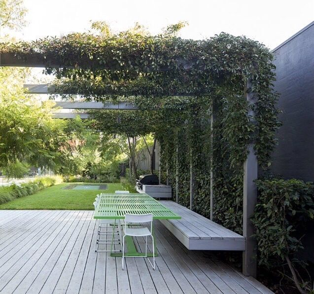 steel structure creates a pergola in the garden | http://adamchristopherdesign.co.uk