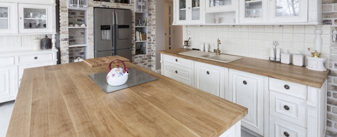 Wood Countertops : Butcherblock is our preferred surface; we enjoy the look of well-used and weathered surface, and it's friendly to those expensive chef's knives.
