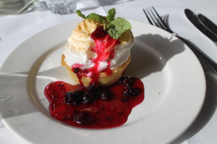 Spectacular desserts from the Queen Adelaide Restaurant onboard. Lemon meringue tart with fresh regional berries...yum!